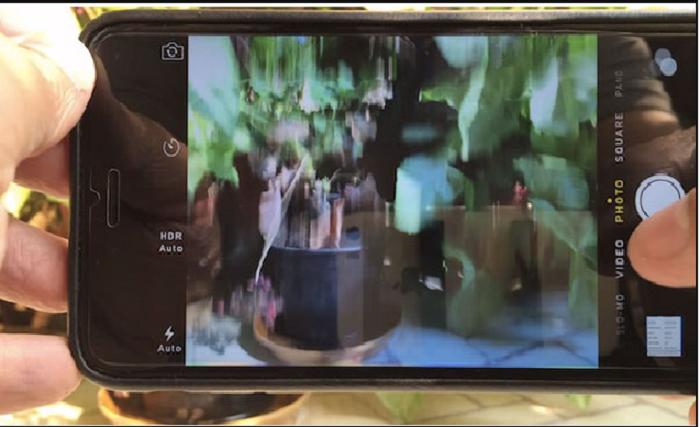 Camera sau iphone 6s plus bị rung